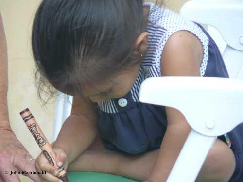 Holding crayon